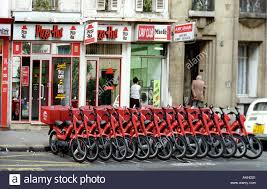 Pizza Delivery Bikes Lined Up Outside Hut In Paris France