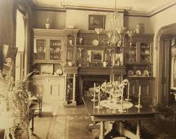 This Beautifully Appointed Victorian Dining Room Features A Fireplace And Well Stocked Hutch 1890s
