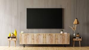 tv auf schrank im modernen wohnzimmer mit holzwand 3d