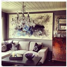 The Mix And Match Of Different Wood Color Statement Chandelier Painting All Add Character To This Living Room Hashtag With Your