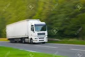 100 Camera Truck Large Plain White With Motion Blur In Effect Stock