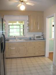 Laying Stone Tile Over Linoleum by How To Use Peel And Stick Vinyl Tiles To Update Your Kitchen