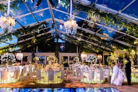 Wedding Dance Floor Over Pool With Flowers On Ceiling