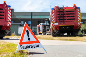 German Feuerwehr ( Fire Department ) Sign Stands Near Fire Trucks ...