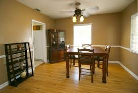 Formal Dining Room With Ceiling Fan And Recently Refinished Hardwood Floors