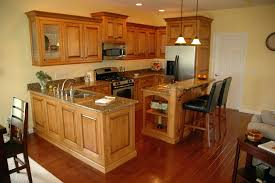 maple cabinets with black granite light countertops modern kitchen