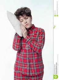 chronic fatigue in red pajamas sleeping standing stock photo