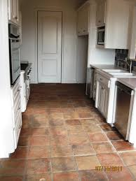 antique terracotta saltillo tile really adds to the appeal of this