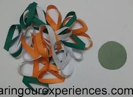 Step 3 Take One Circle Cut Out And Start Pasting The Green Loops On It As Shown In Pic Below These Will Be Petals Of Tricolour Flower