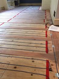 This Image Shows A Loose Cable System On Wood Sub Floor The Installer