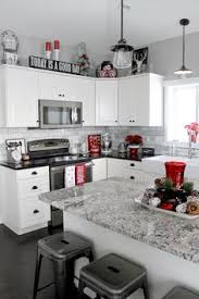 Red And Black Living Room Decorating Ideas by Decorate Above Kitchen Cabinets Home Decor Decorating Above The
