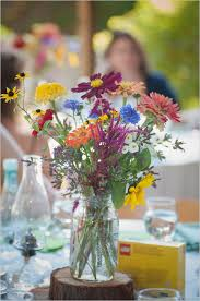 Colorful Wildflower Centerpiece Is Perfect For A Backyard Or Rustic Wedding