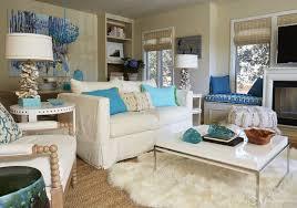 Living Room Pendant Desk Lamp White Loveseat Armchair Blue Futon Coffee Table Carpet Stool Painting Window Curtain Television Fireplace Flower Vase Books