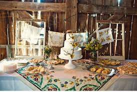 Barn Wedding Cake Table With Vintage Tablecloth
