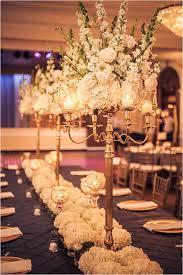 Tall Candleabra With White Flower Arrangement Elegant Wedding Decor Photo Ama Photography