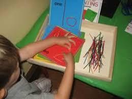 Preschooler Forming Numbers With Wikki Stix
