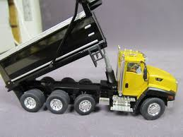 Caterpillar CT660 Yellow Dump Truck - DieCast Masters - Product ... Caterpillar D250e Articulated Dump Truckdhs Diecast Colctables Inc 1102 Nissan Diesel Truck Purple Made In Japan Tomica 16 Ebay Diecast Replica Kenworth 132 Scale Toy For Kids Tonka Tough Cab Site Intertional Orange Showcasts 2113d 5 Inch Long Haul Trucker Newray Toys Ca Cstruction Diecast Model Dump Trucks Articulated And Fixed Conrad 150 Man F8 Atlas Awesome Top Race Metal Heavy Authentic 1950s Dinky Toys Bedford Die Cast Dump Truck Ct660 Yellow Masters Product Buy Rianz All New New Imported Die Cast Trucks Set Of 3