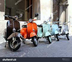 Classic Italian Scooters Parked In Ancient Street Old Town At Treviglio Vintage Festival Piaggio Vespa