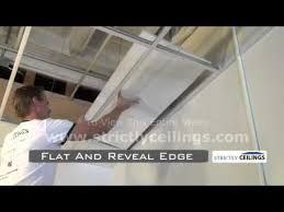 installing 2x2 2x4 drop suspended ceiling tiles into ceiling