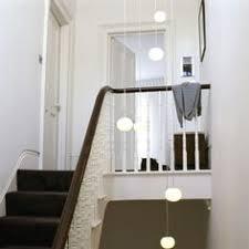 multi coloured vertical stairwell chandelier at juliettes