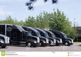 100 Big Black Trucks Modern Rigs Semi In Row On The Parking Lot Stock