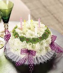Happy Birthday flower cake with white carnations green poms and bows
