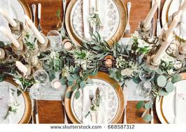 Aerial View Of Winter Green Garland On A Wedding Receptions Head Table With Gold Place Setting