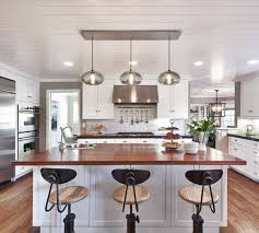hang three pendant lights with a lighting canopy