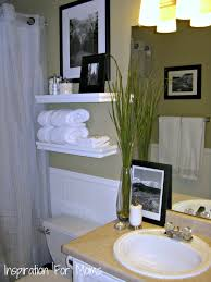 excellent white wooden floating shelves as towel storage as well