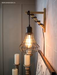 hanging cage light from a in light and a wood bracket