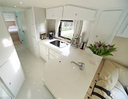 Stylish Living This Bus Boasts A Slick White Kitchen Area With Large Fridge Freezer