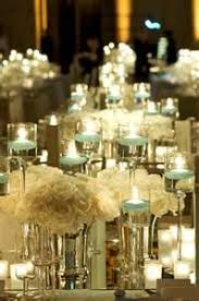 Ambiance Beautiful Use Of Candles And Flowers To Create Your Photo Credit Candle CenterpiecesCenterpiece IdeasWinter Wedding