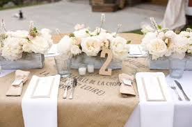 French Rustic Tablescape With Linen Sack Runner And Boxed Floral Centerpieces Votives