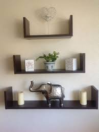 Three Panel Black Wooden Wall Shelving Living Room On White Painted