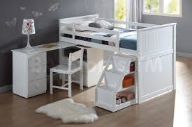 white kids loft bunk bed with desk and under stairs storage