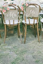 Rustic Wood And Floral Wedding Chair Decor For Bride Groom