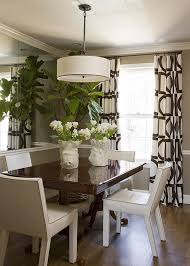 Lovely Drapes And A Large Pendant Add Style To The Small Space Dining Room With Mirror