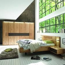 wöstmann wsm 1600 schlafzimmer 2 teilig europäische wildeiche massivholz bestehend aus bettanlage und drehtürenschrank liegefläche wählbar