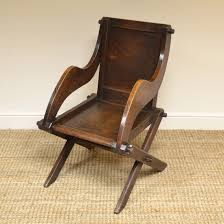 Victorian Arts And Crafts Solid Oak Antique Glastonbury Chair Victorian Arts And Crafts Solid Oak Antique Glastonbury Chair Original Primitive Press Back Rocking 1890 How To Appraise Chairs Our Pastimes Bargain Johns Antiques And Mission Identifying Ski Country Home Replace A Leather Seat In An Everyday Wooden High Chair From 1900s Converts Into Rocking Lborough Leicestershire Gumtree Sold Style Refinished Maple American Style Childs Antiquer Rocker Reupholstery Vintage