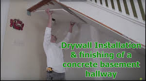 Installing Drywall On Ceiling In Basement by Drywall Installation U0026 Finishing Of A Concrete Basement Hallway