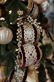 Gold Tree Picks Mixed In With Christmas Ornaments Burgundy And Ideas