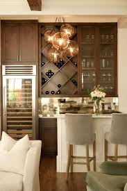 Chic Living Room Bar Features Dark Stained Shaker Cabinets Paired With White Marble Countertops