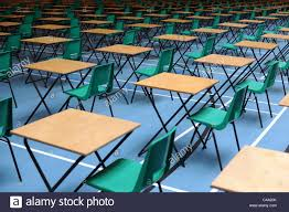 100 College Table And Chairs Empty Desks And Chairs Set Out For A School Or College Examination