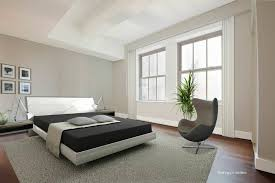 contemporary guest bedroom with carpet laminate floors in new