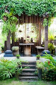 Rustic Stand Alone Pergola With Tropical Climbers