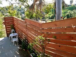 Horizontal Deck Railing Ideas by Building A Horizontal Plank Fence Hgtv