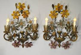 pair of antique bronze two light wall sconces with 9 cut
