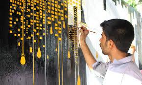 A Student Painting The Wall At MT Khan Road Karachi