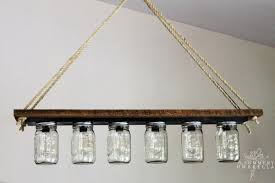 Chandelier Over Bathroom Vanity by Remodelaholic Upcycle A Vanity Light Strip To A Hanging Pendant