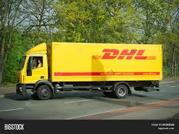 DHL Iveco Euro Cargo Truck Image & Photo | Bigstock Dhl Truck Editorial Stock Image Image Of Back Nobody 50192604 Scania Becoming Main Supplier To In Europe Group Diecast Alloy Metal Car Big Container Truck 150 Scale Express Service Fast 75399969 Truck Skin For Daf Xf105 130 Euro Simulator 2 Mods Delivery Dusk Photo Bigstock 164 Model Yellow Iveco Cargo Parked Yellow Delivery Shipping Side Angle Frankfurt